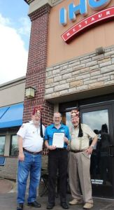 Shriners Fred Lemieux (L) and Carl Ellis (R) with IHOP Area Manager Todd Chraden, who holds a proclamation from Mayor Reid.