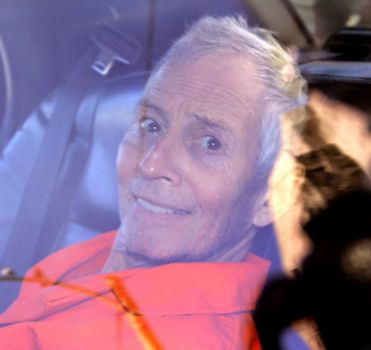 (Photo By Gerald Herbert/AP)  FILE - In this Tuesday, March 17, 2015 file, Millionaire Robert Durst is escorted from Orleans Parish Criminal District Court to the Orleans Parish Prison after his arraignment in New Orleans. Durst is going back to court in New Orleans after nearly a week in a prison mental ward 70 miles away. At a preliminary hearing on weapons charges on Monday, March 23, his lawyers planned to argue that the 71-year-old Houston man should be released because he was illegally arrested on those charges and a Los Angeles County warrant accusing him of murdering a female friend.