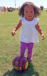 Kristi Nix One-year-old Parker Cathus honed her soccer skills on the sidelines during her big sister's game.