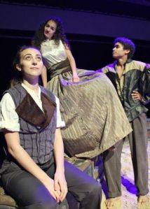 """A strange love triangle ensues in Dawson High School's production of """"Twelfth Night"""" as Orsino (Antonio Lasanta, far right) falls for Lady Olivia (Rola Elkhatib, middle), who in turn falls for his disguised pageboy Cesario (Lauren Bass, far left)."""