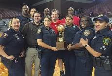 Cruz poses with Officers that provided security during the game; (Photo: Chris Daigle)